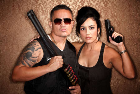 Attractive male and female undercover cops with firearms photo