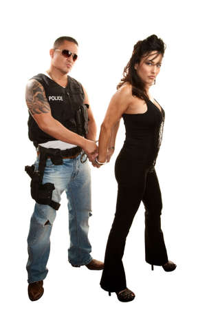 Handsome mexican cop arresting pretty Latina woman photo