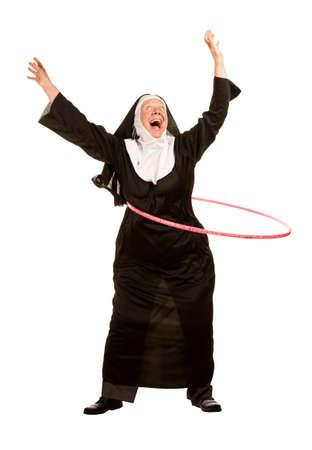 nun: Funny nun excercising with toy plastic hoop