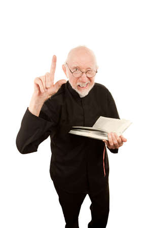 Senior priest or pastor giving a fiery sermon from the Bible