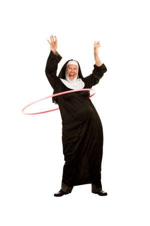 religious habit: Funny Nun Playing with Toy Plastic Hoop on White background