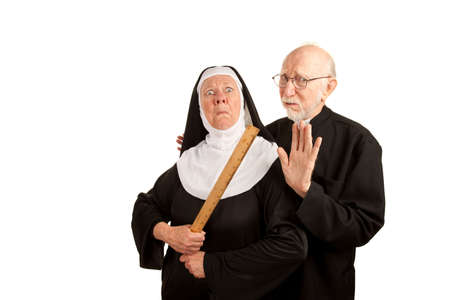 religious habit: Funny priest warning about angry nun with ruler as weapon Stock Photo