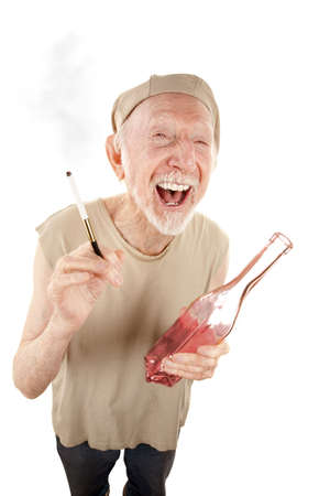 wino: Ragged senior man with liquor bottle and cigarette Stock Photo