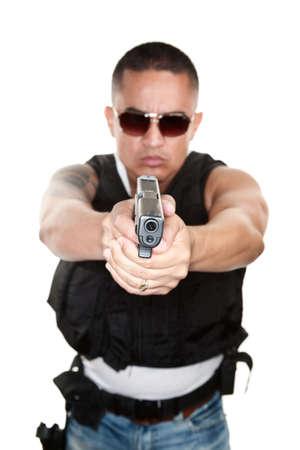 Tough Latino Cop Pointing Pistol at Camera photo