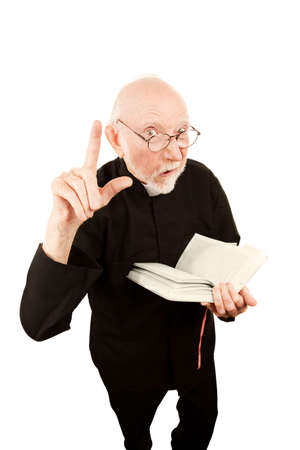 Senior pastor delivering fiery sermon and holding a Bible photo