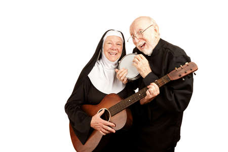 religious habit: Funny priest and nun with musical instruments on white background Stock Photo