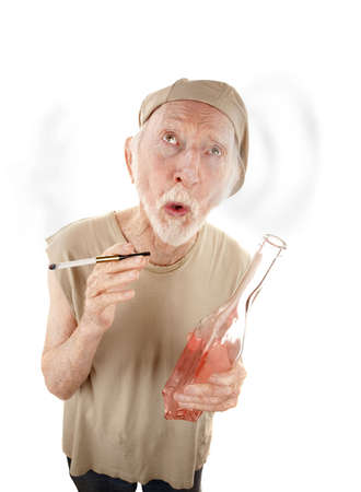 inebriated: Senior man with liquor bottle blowing smoke rings