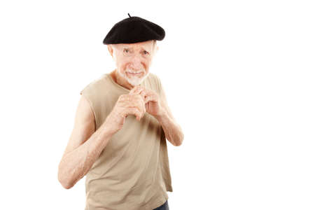 defensive posture: Senior man wearing beret in fighting stance