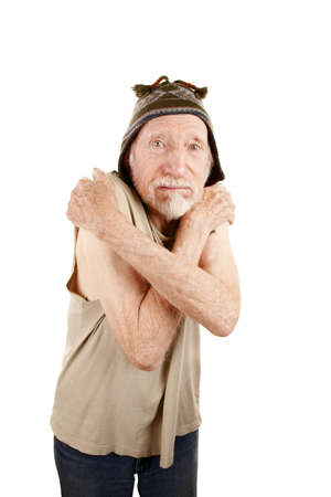 Ragged elderly man in t-shirt and knit cap Stock Photo - 6430240