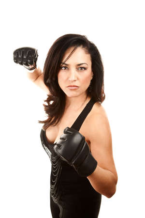 dressy: Pretty Latina Woman in Dressy Clothes with Boxing Gloves Stock Photo
