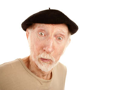 Senior man in black beret with surprised expression photo