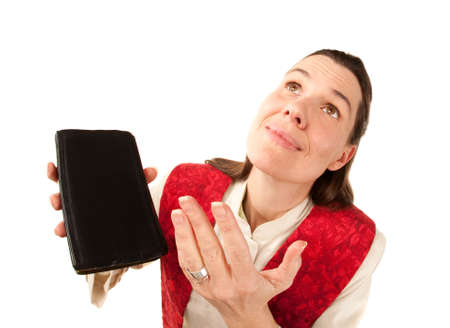 Female pastor with Bible making  big prayer gesture to God or heaven Stock fotó