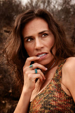 Pretty woman outdoors with her hand to her mouth Stock Photo - 6500962