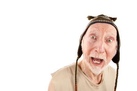 indigent: Senior man with surprised expression wearing knit cap