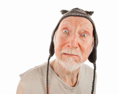 ragged: Crazy senior man in ragged shirt and knit cap