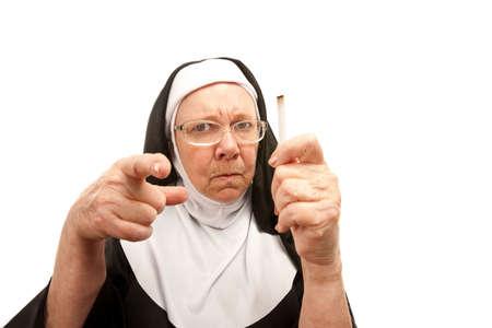 reprimanding: Stern nun reprimanding over a discovered cigarette