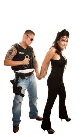 Hispanic cop arresting pretty Latina woman photo