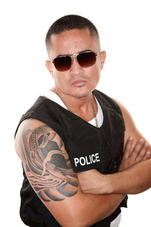 tattoo arm: Tough Hispanic Cop in Bulletproof Vest and Sunglasses Stock Photo