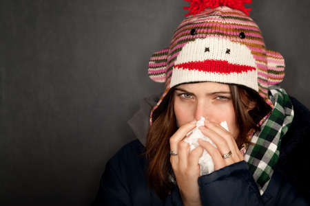 Pretty young woman with either flu or cold photo