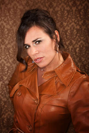 Pretty woman in leather coat on gold background Stock Photo - 6501037