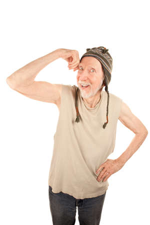 indigent: Eccentric senior man in knit cap flexing his muscle Stock Photo