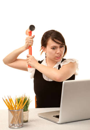 pc: Pretty female office worker destroying laptop computer Stock Photo