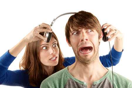 bother: Pretty young woman interupts man with headphones