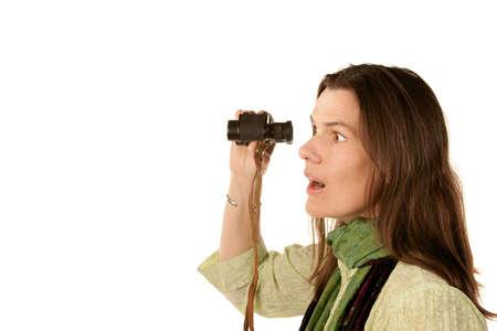reacting: Pretty adult woman reacting after using binoculars