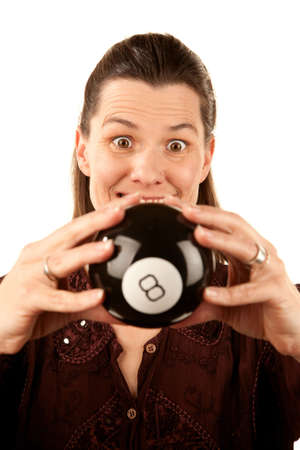 eightball: Pretty adult woman reading the future from a toy eightball