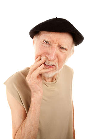Confused senior man with hand to face wearing a beret Stock Photo - 6569855