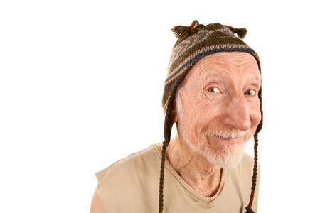 Smiling senior man on white background in knit cap
