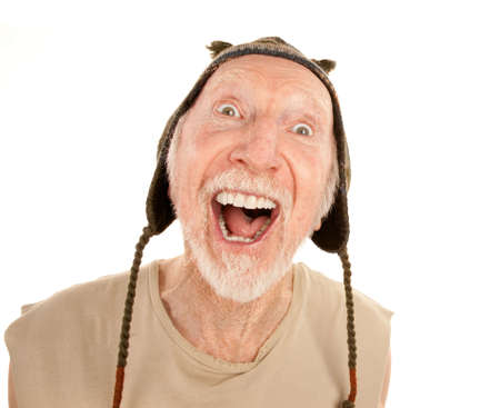 agape: Laughing senior man on white background in knit cap