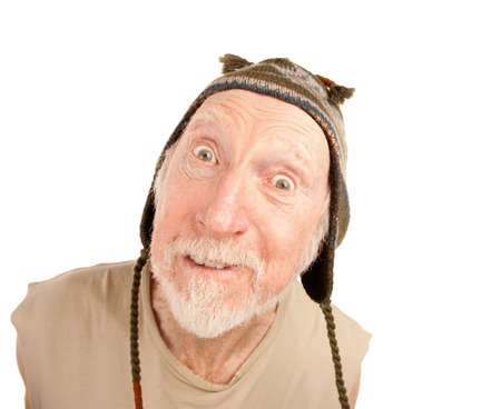 Confused senior man on white background in knit cap Stock Photo - 6569784