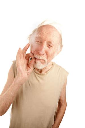 reefer: Senior man in ragged shirt smoking cigarette stub or marijuana reefer