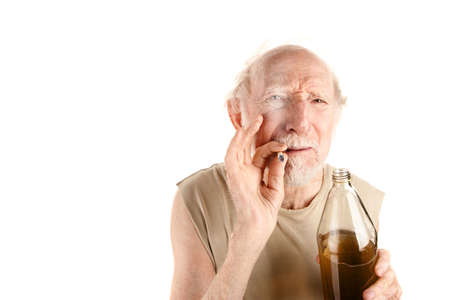 alcoholic man: Senior man in ragged shirt with cigarette stub and alcohol