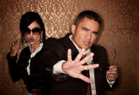 Attractive Hispanic couple caught in a paparazzi photographer flash