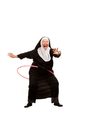 Playful nun on white with plastic hoop
