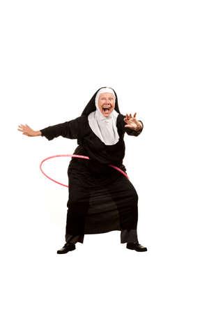 nun: Playful nun on white with plastic hoop