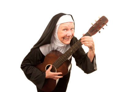 religious habit: Funny singing nun with old guitar and religious habit Stock Photo