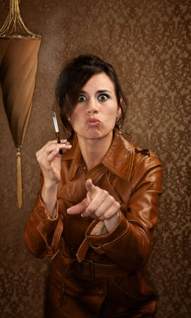 Woman in dark leather coat with cigarette Stock Photo - 6631005