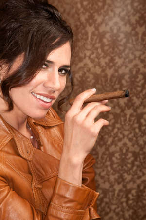 cigar smoking woman: Woman in dark leather coat with cigar