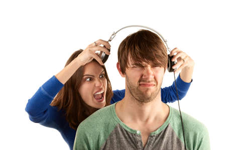 spat: Pretty young woman interupts man with headphones