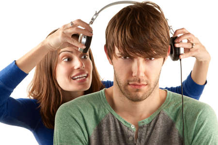 annoy: Pretty young woman interupts man with headphones