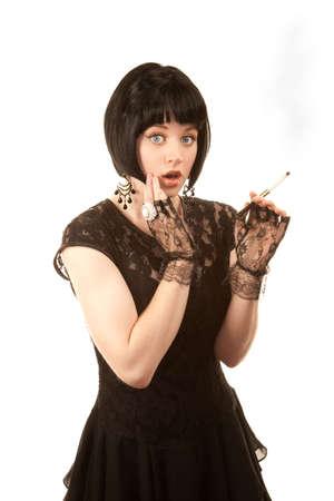 Retro woman with black hair and Parisian 1950s dress photo