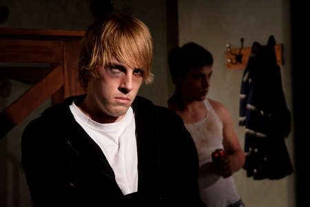 menacing: Frightened young man with menacing alcoholic