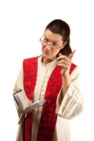 stole: Pastor in white robes with Bible and red stole