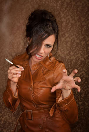 Woman in dark leather coat with cigarette photo