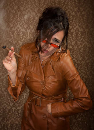 Woman in dark leather coat with cigar Imagens - 6727536