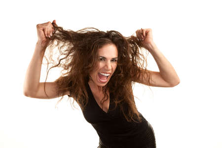 Pretty woman with wild brunette hair on white background photo