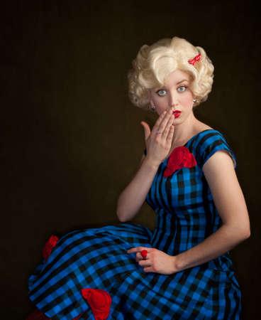 Pretty retro blonde woman in vintage 50s dress